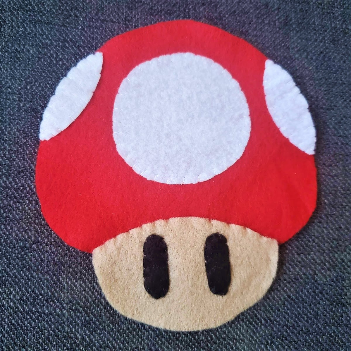 Image of front face piece sewn to front red mushroom top