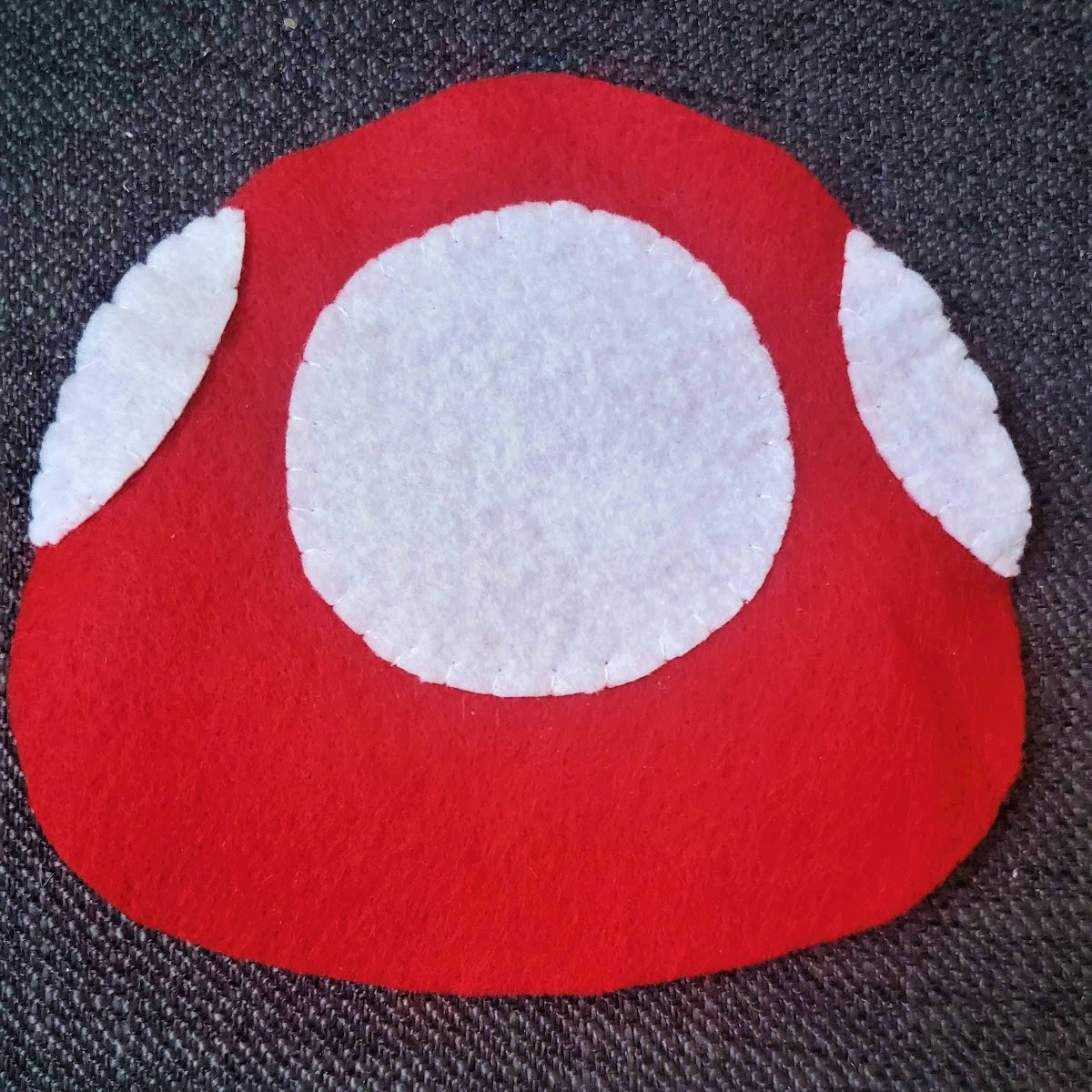 Image of white spots attached to red mushroom top