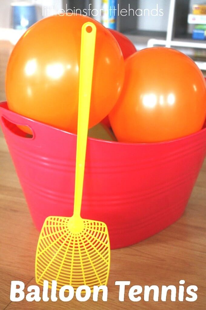 balloons in a basket and plastic swatter