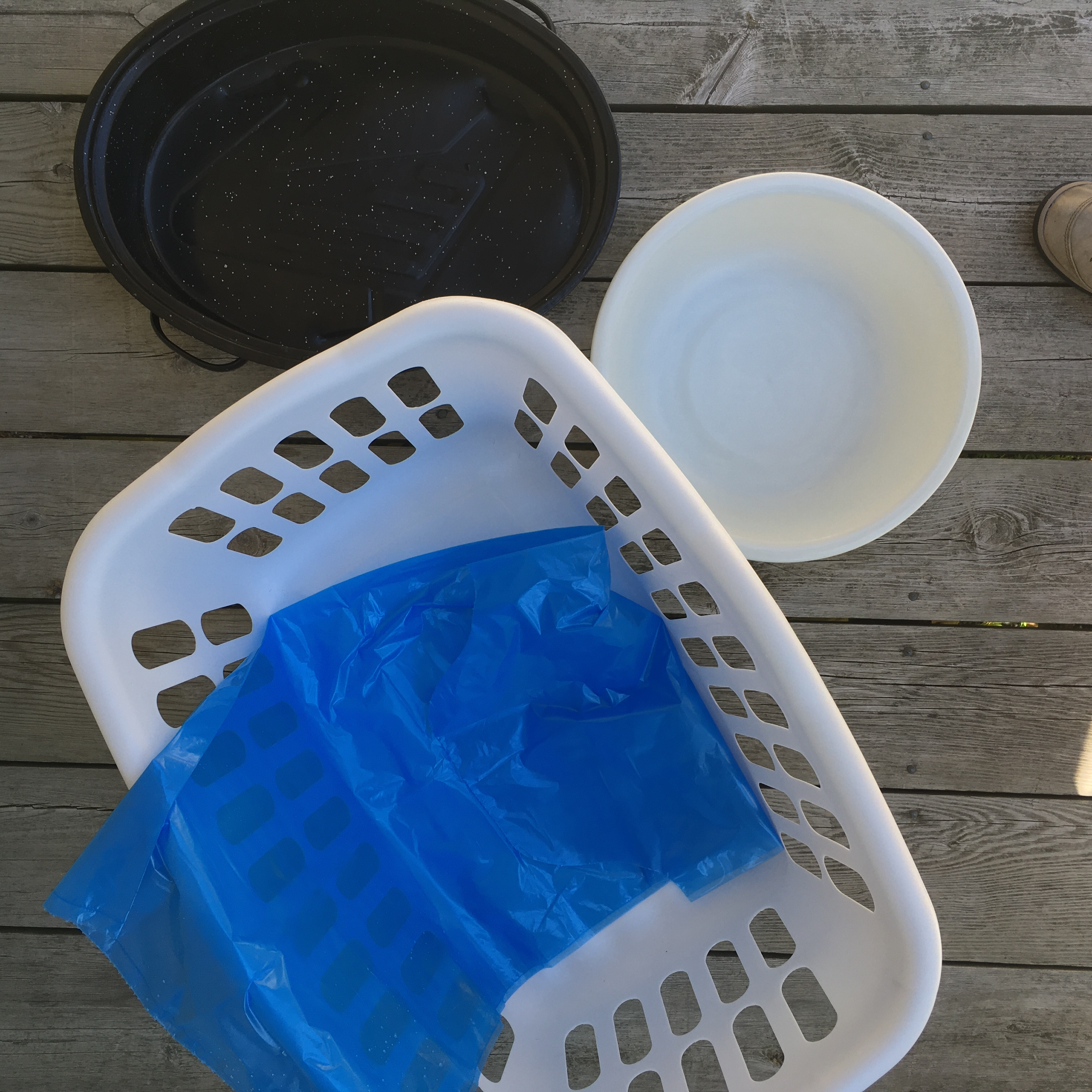 laundry basket, roasting pan, bucket, and blue bag
